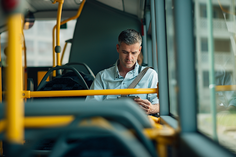 businessman-traveling-by-bus-PTWGUUH_sma