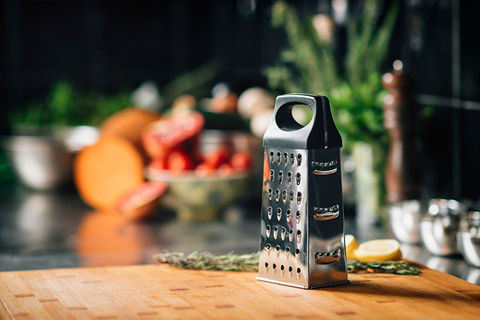 grater-on-wooden-cutting-board-in-restau