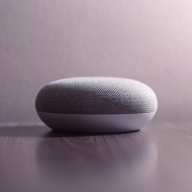 white-and-gray-bluetooth-speaker-on-brow