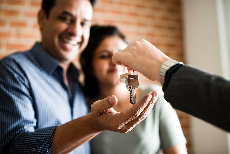 cheerful-couple-with-keys-to-their-new-h