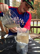 Homeschool science and engineering course - student building a water filter