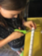 Homeschool science and engineering course - student building pape rollercoaster