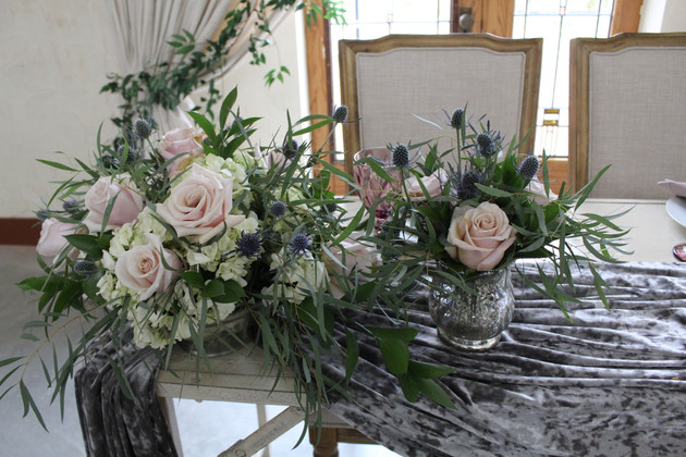 Pink Roses reception decorations Thistle Flower Bar
