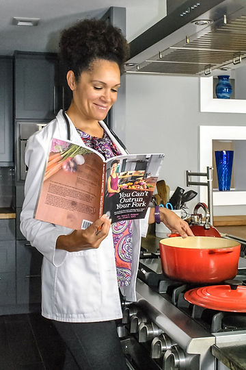 cooking in kitchen with book.jpg