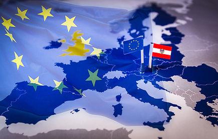 EU and Austria flag over an european uni