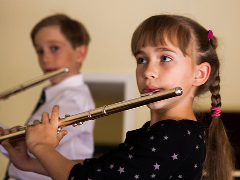 Children playing flute