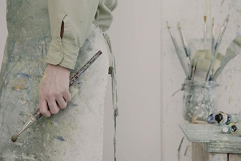 Artist Holding a Paintbrush_edited.jpg