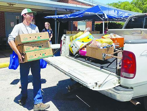 Group steps in to help farmers, community