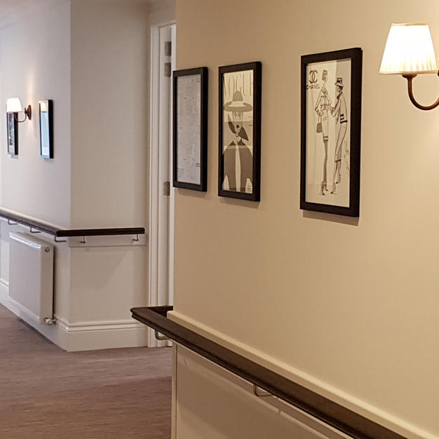 Embracia hallway wall lights in Antique Bronze