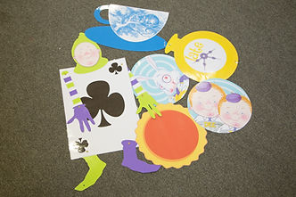 Assorted laminated Alice in Wonderland images