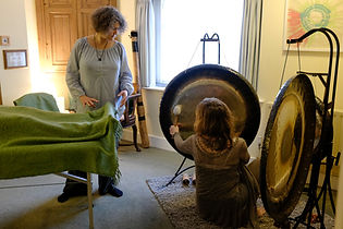 Our staff setting up the gong for a session held at a workplace