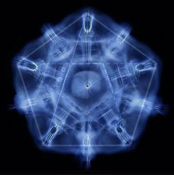 The blue image is a Cymatic Pentagon created by sound. Photo byErik Larson
