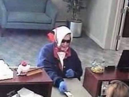 """An old lady handed her bank card to the teller and said """"I would like to withdraw $10""""."""