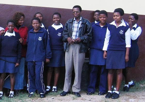 Head teacher and students.JPG