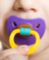 Child suck pacifier