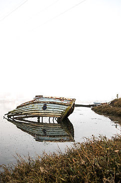 Old Wrecked boat in shallow water
