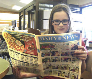 COMICS FIND NEW VENUES, BUT REMAIN POPULAR WITH READERS