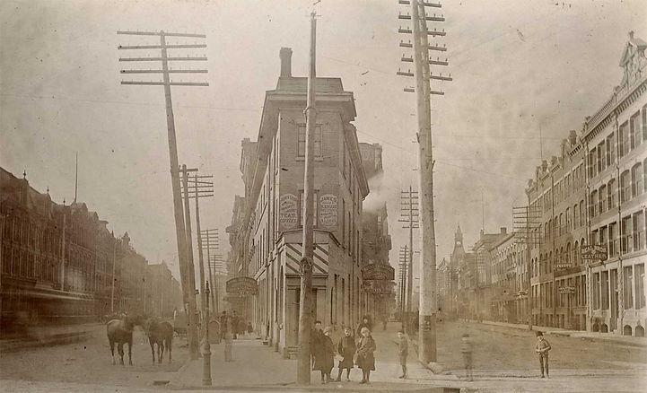 Corner of Front and Wellington circa 1888  Unknown Photographer [Public domain or Public domain], via Wikimedia Commons