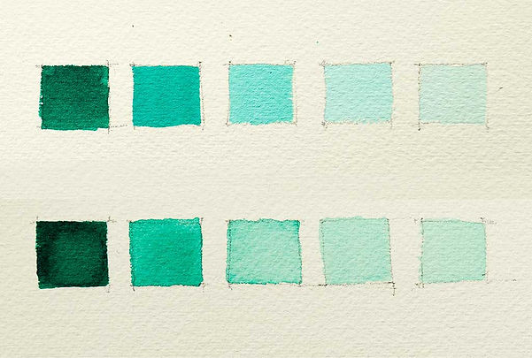 Swatches of phthalo green watercolor