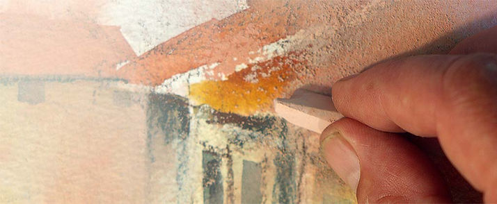 Pastel being applied over watercolor