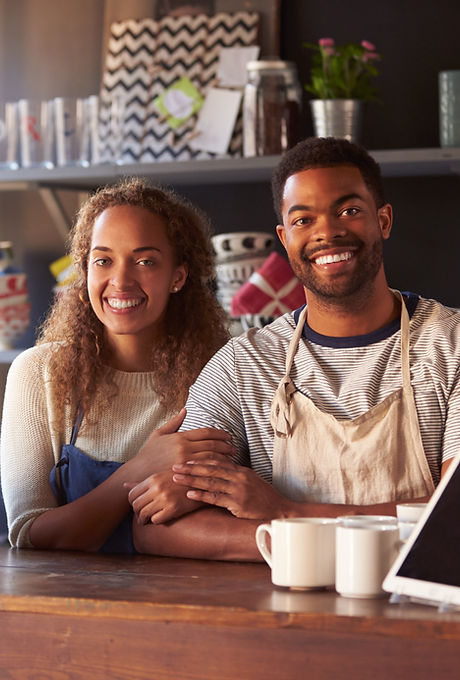 Portrait Of Couple Running Coffee Shop B