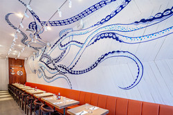 Booth seating with octopus wall art
