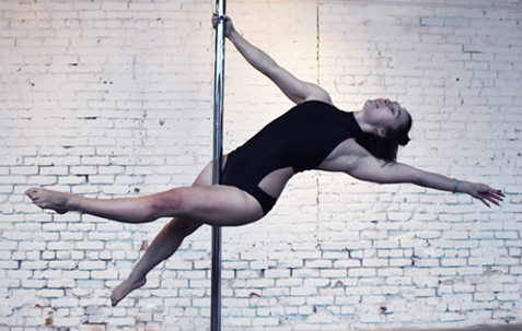 Pole Instructor Doing Trick on Pole