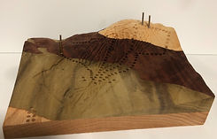 cribbage board with ski trails as pegging lines, carved on Saddleback Ski Mountain in Rangeley, Maine