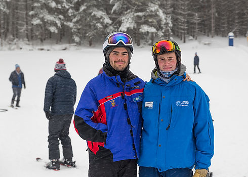 Alex Gemme and Jacob Freedman teach ski lessons at the Middlebury College Snow Bowl
