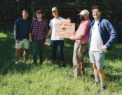 Treeline Terrains members presenting a wooden model to MALT at Otter Creek Park