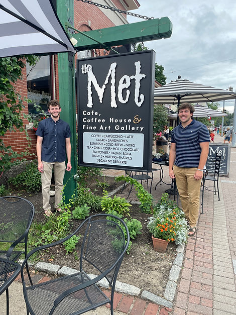 Jacob Freedman and Nathaniel Klein outside The Met Cafe, Coffee House, and Fine Art Gallery