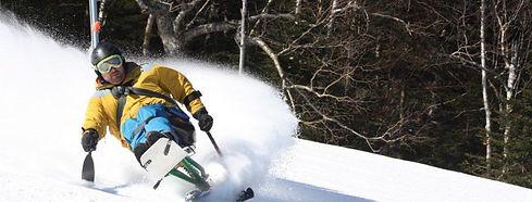 Disabled monoski athlete skiing on powder ski slope