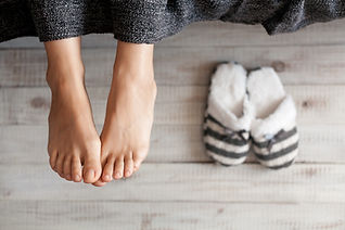 Soft photo of woman feet with slippers,