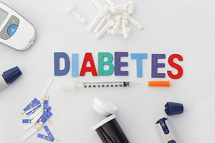 Word DIABETES with insulin syringe,lance