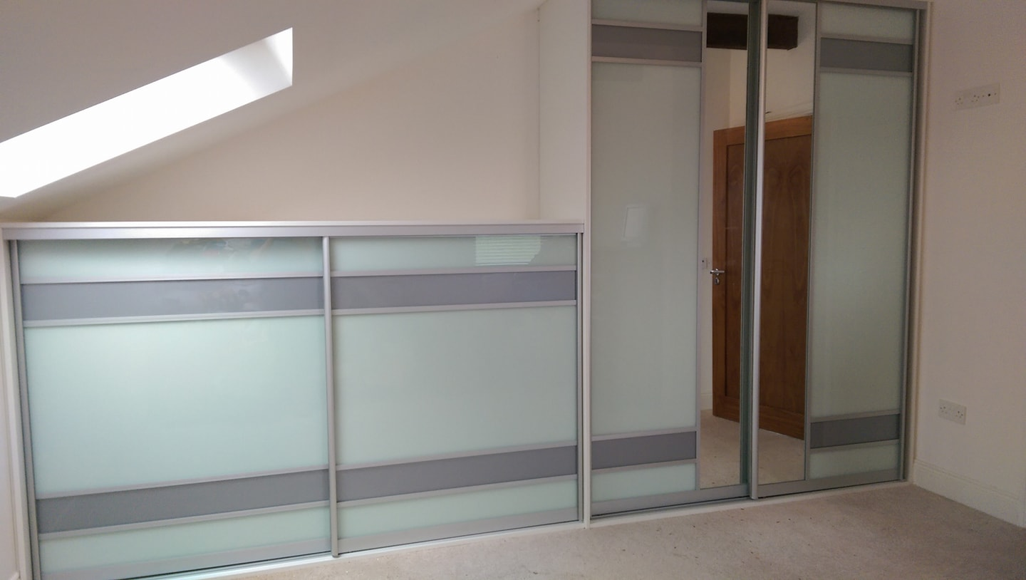 unusual soft white sliding doors with a strip of silver glass and a vertical mirror fitted by slidin