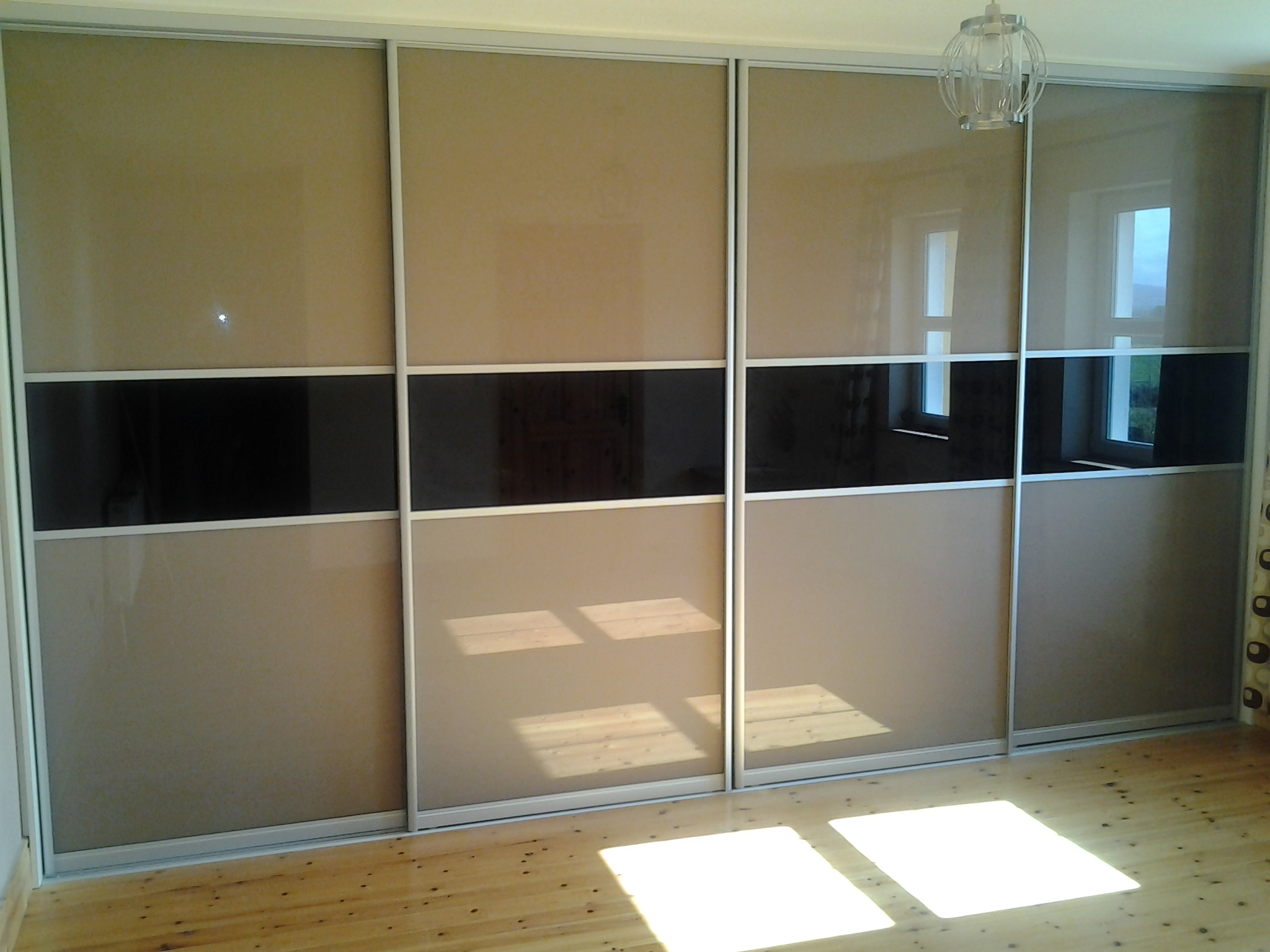 beige glass and black sliding doors