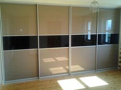 beige glass and black sliding doors
