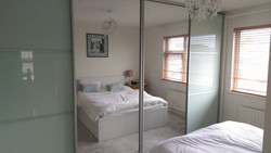 soft white glass and mirror sliding doors fitted by sliding wardrobes direct