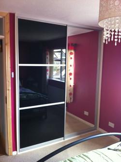 black glass and mirror sliding doors