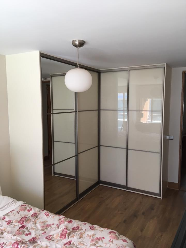 fantastic L shaped sliding wardrobe with ivory and mirror sliding doors
