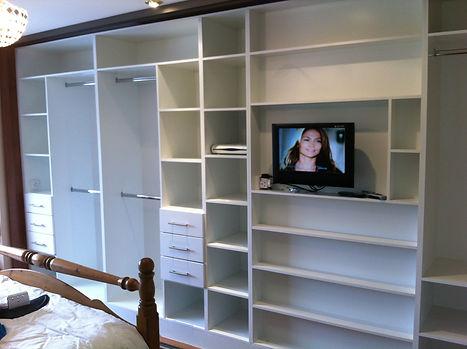 sliding wardrobe interior with built in chimney breast
