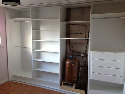 sliding wardrobe interior with built in water heater