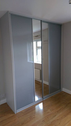 silver glass and mirror sliding doors divided virtically fitted by sliding wardrobes direct