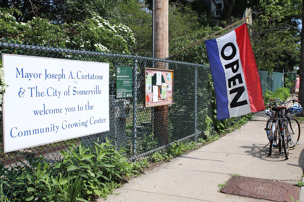 """The Growing Center fence, with the """"Open"""" sign out."""
