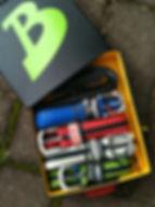 Some BUCKiT belts in a box