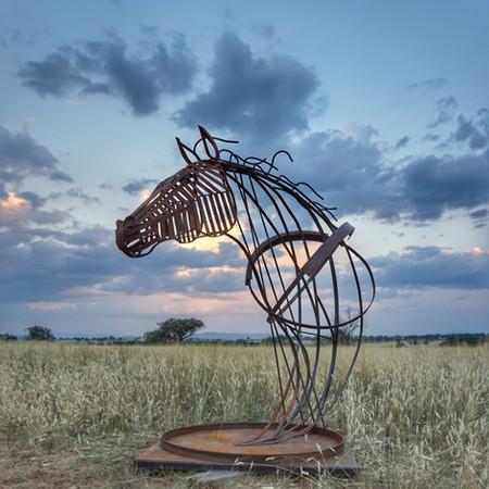 Nodding metal horse head
