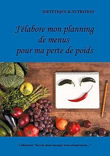 Livre diététique représenant un carnet, un crayon et des légumes verts