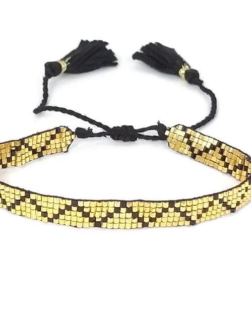 Pulsera con beads de piedras naturales color dorado y negro