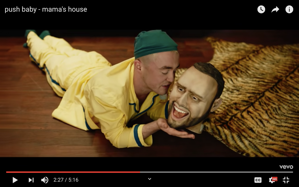 Push Baby requested his producers head to feature in his music video, Scooter Braun.