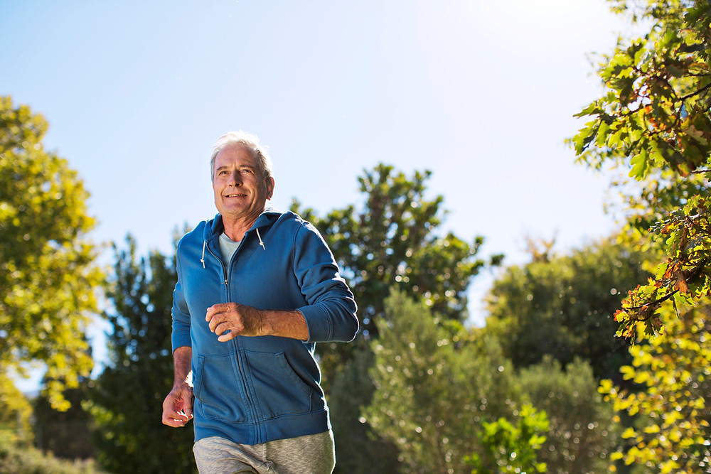 Senior exercising by running